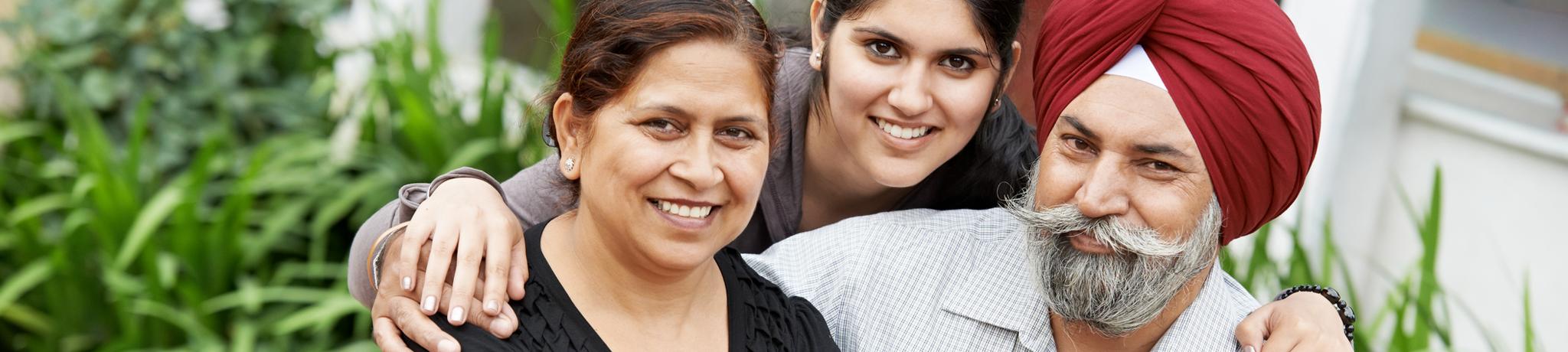 Smiling Sikh family
